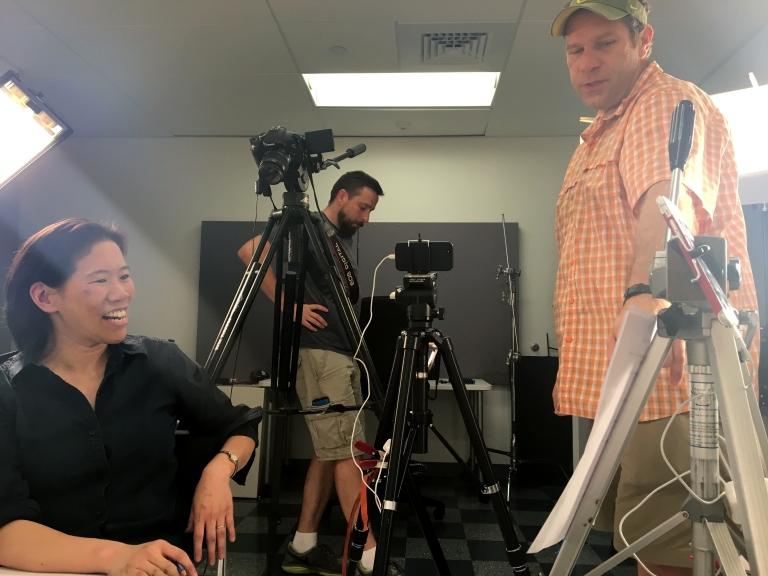 Clara Lieu, Thomas Lerra, and Alex Hart on the Art Prof set